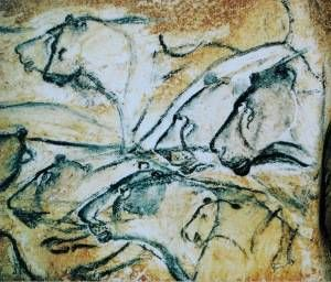 Photograph of a group of lions, painted on the walls of Chauvet Cave in France, at least 27,000 years ago. Photo by HTO