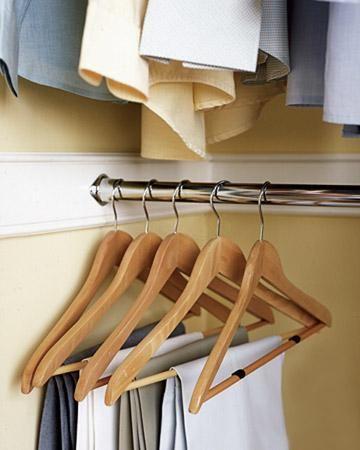 The same felt glides that keep scratches off wood floors keep pants on wood hangers.