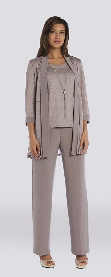 c4b31ce0c26b9 Stunning mother of the bride pant suit dress. This textured metallic mock  three-piece pantsuit is designed for effortless coordination