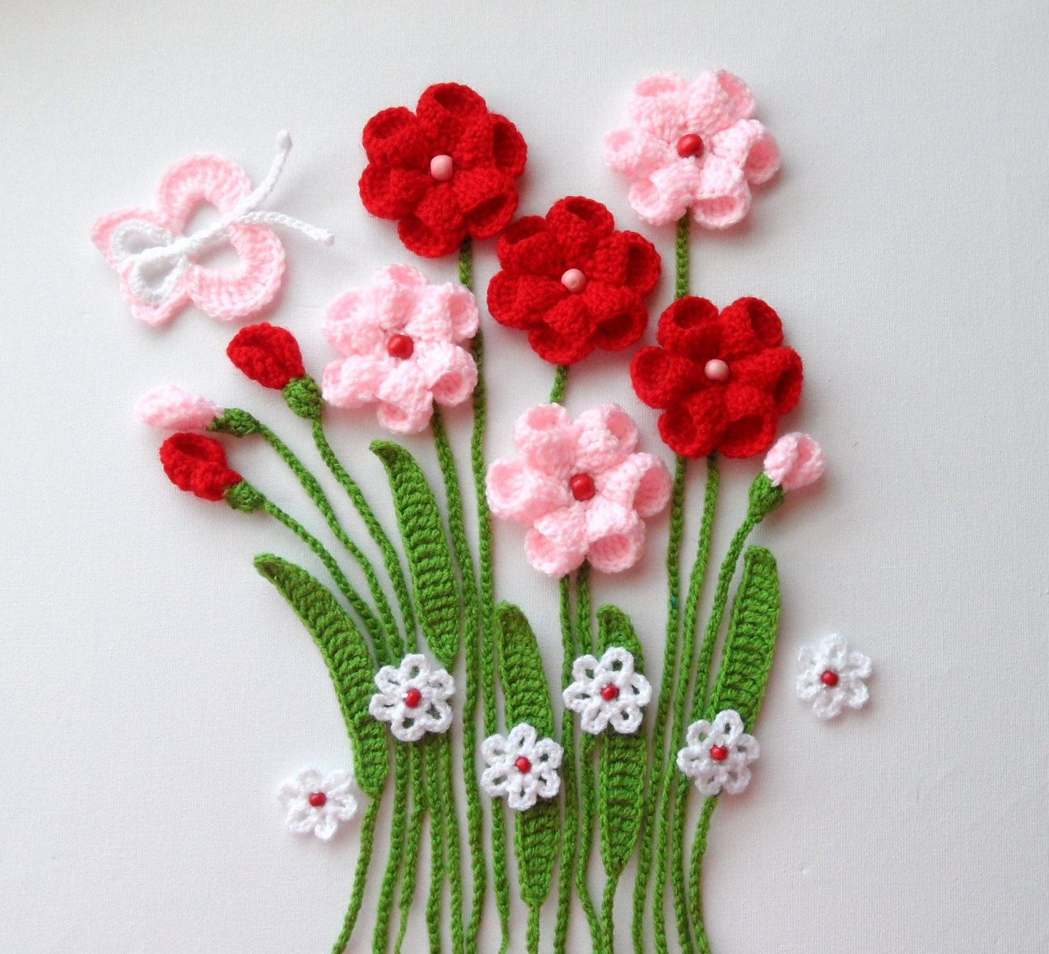 Crochet applique flowers and leaves set flowers in the meadows
