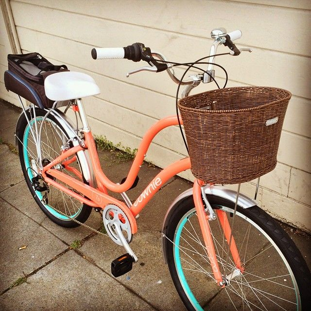 Fully loaded Electra Townie 7D Ladies in Coral. Top to bottom: Electra basket, Electra rack trunk, Kryptonite seat leash (discreetly installed), Electra Townie rack, Electra Townie fenders, and Pinhead locking skewers.
