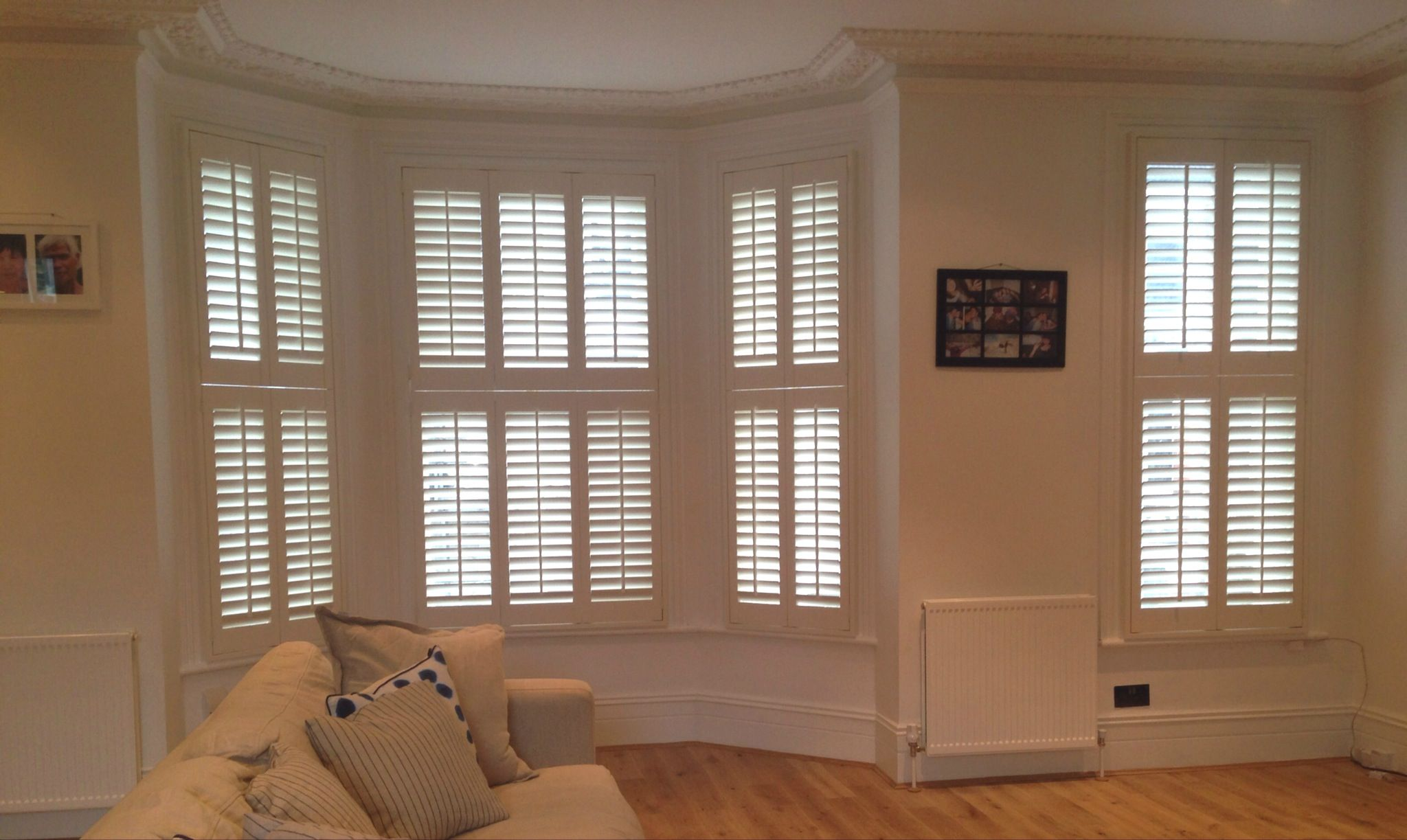 Home shutter gallery tier on tier shutters tier on tier shutters - Very Traditional Central Tilt Rod Tier On Tier Wooden Shutters In This 3 Paneled Bay