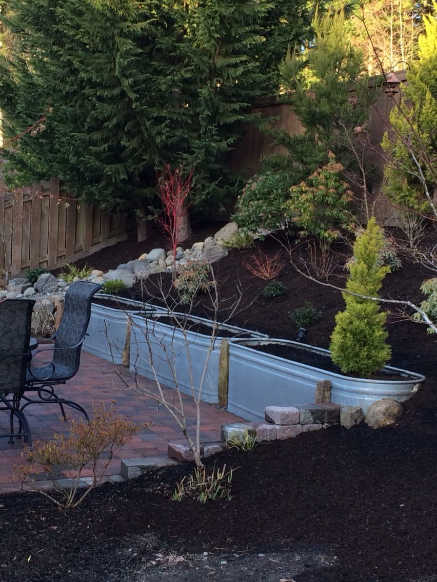 Water trough retaining wall I will use for bulbs, veggies and herbs. Install was a breeze! Perfect retaining wall!