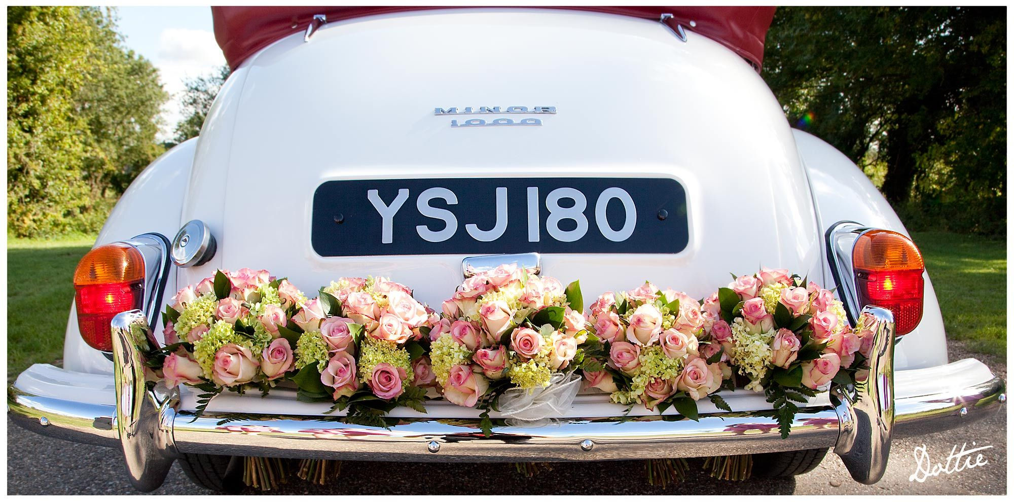 Wedding decorations for car  flowers on back of car  Flowers and cars  Pinterest  Wedding cars