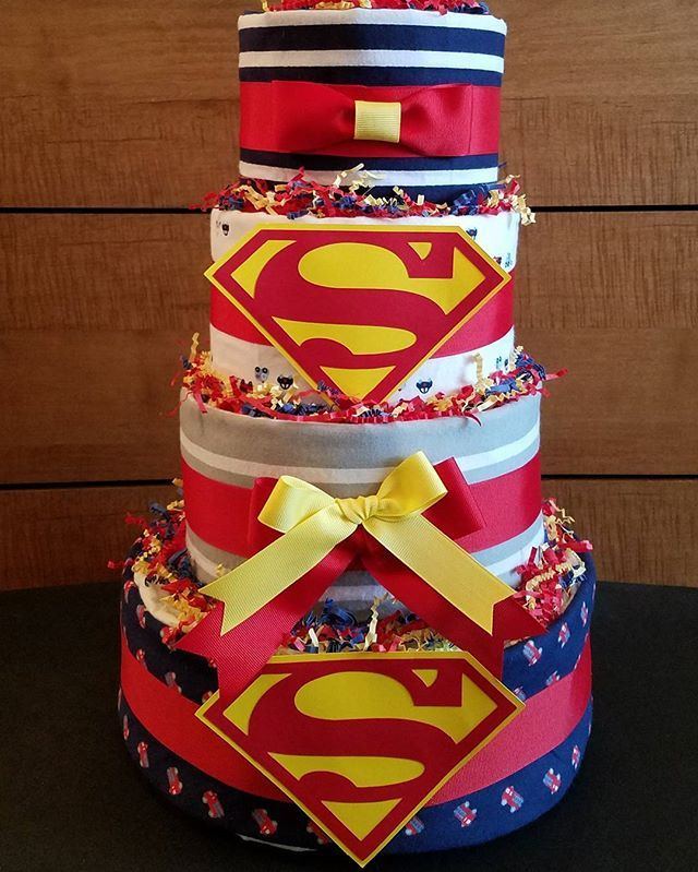 4 Tier Superman Themed Diaper Cake By #giftedoccakesionsnbaskets #babyshower  #gift #diapercake #