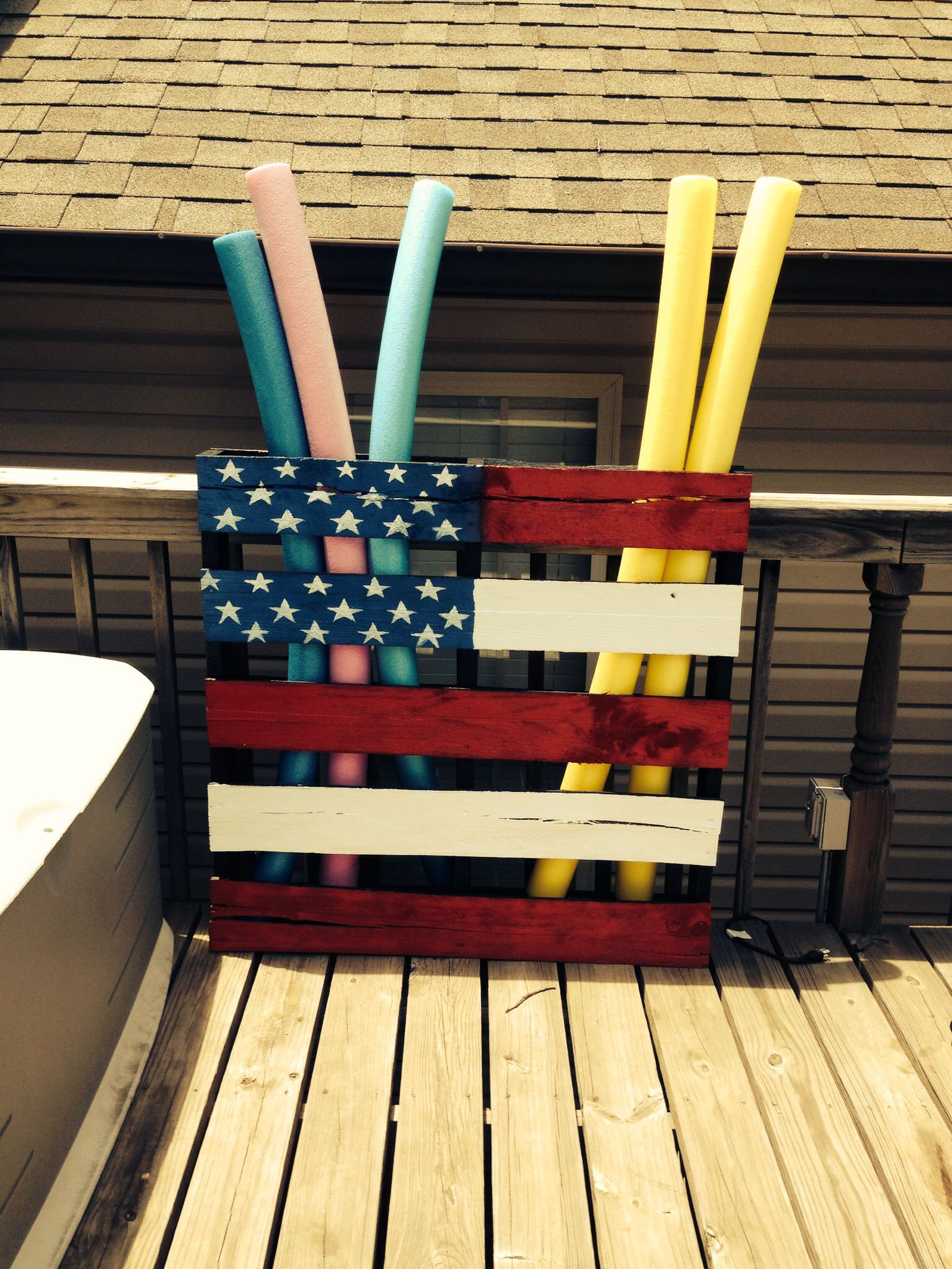 Pool noodle storage from painted pallet outside summer for Above ground pool storage ideas