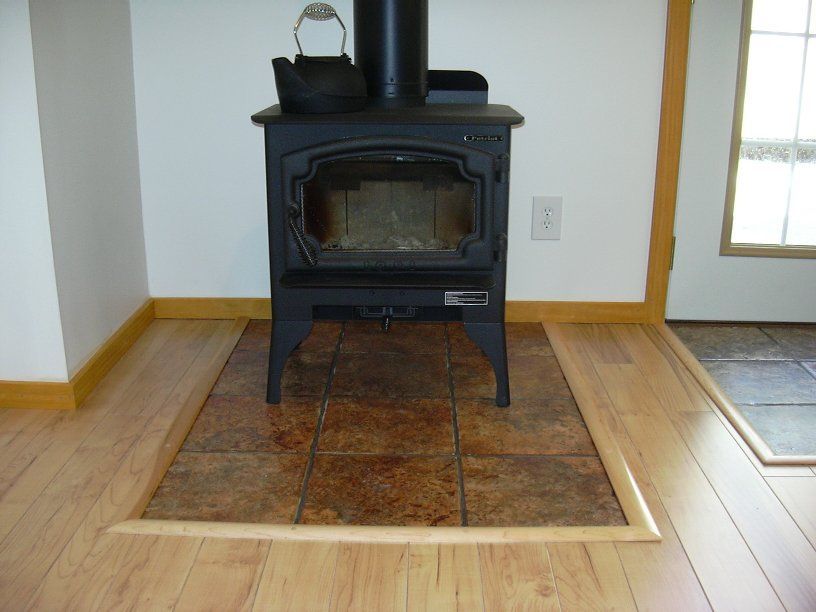 How to transition wood floor around wood stove google for Floor hearth