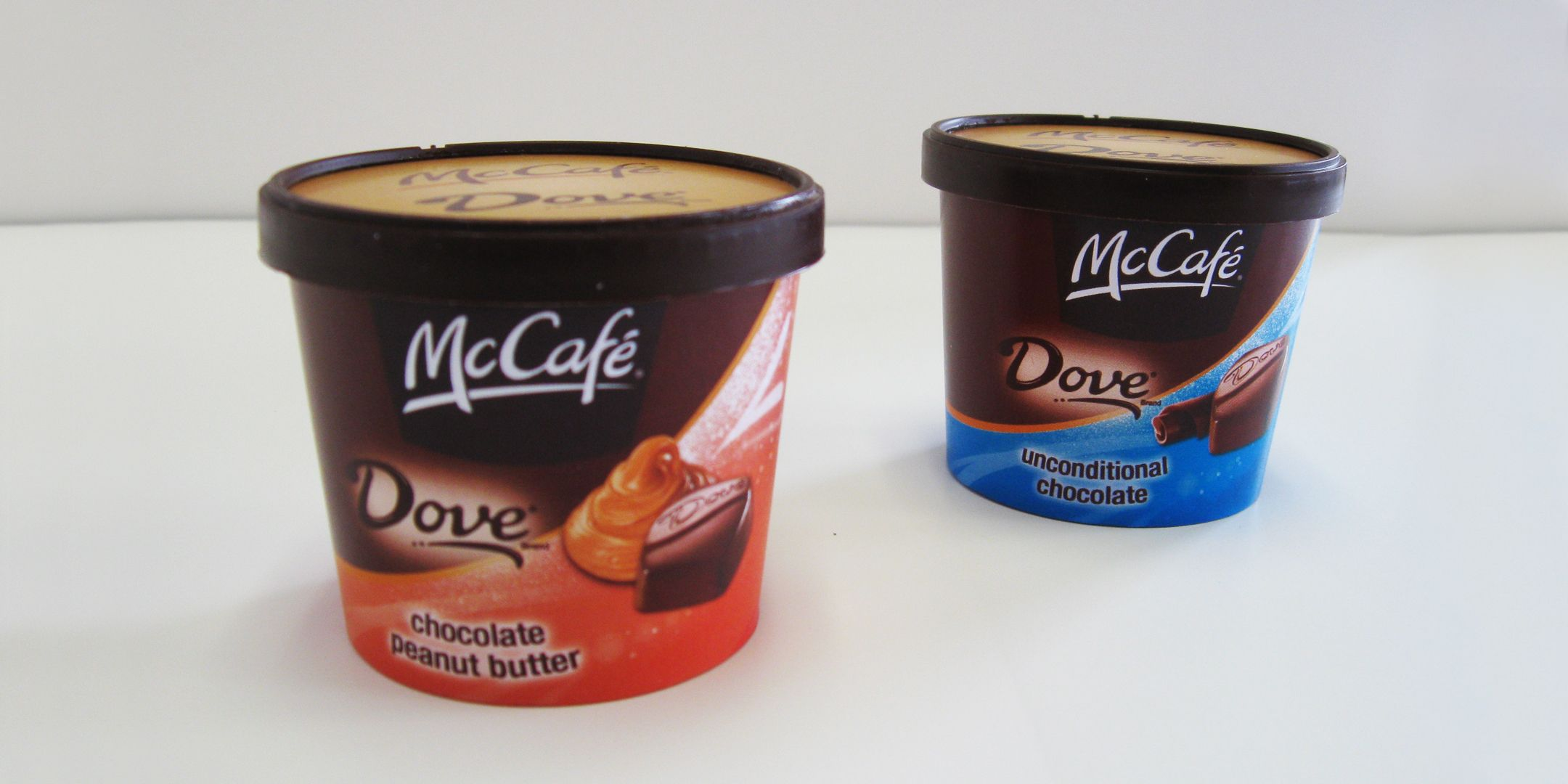 Dove Brand, Mc Cafe Tub - Brand graphics were created, printed and wrapped around supplied paper ice cream tubs. Plastic lid was sprayed to match brand color guide.