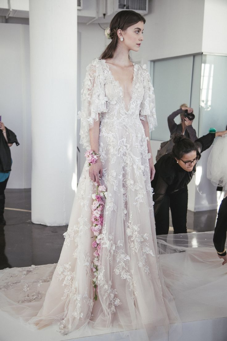 Cool love the flowers on wrist Ethereal Gowns Backstage Marchesa Fall Bridal Photo The LANE