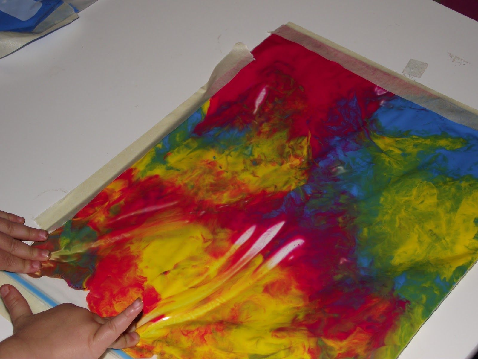Paint in a ziplock taped down to a piece of paper = No mess finger painting.