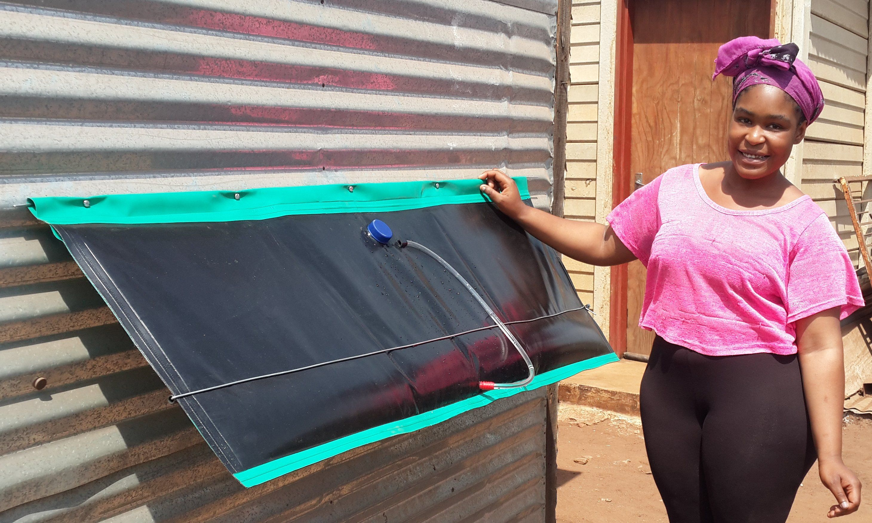 A cheap DIY solar hot water geyser for shacks or sheds. It ...