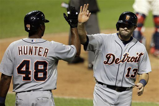 Detroit Tigers' Alex Avila, right, is congratulated by Torii Hunter after Avila scored on a single by Detroit Tigers' Andy Dirks in the ninth inning of...