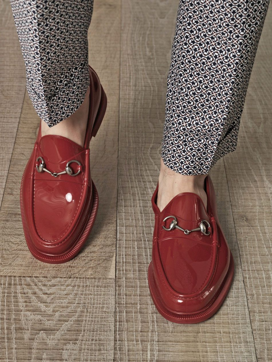 8044ed0c3c7 Red rubber loafers with a round-toe and a gunmetal signature horse-bit  front detail. Internationally renowned since the 1960 s