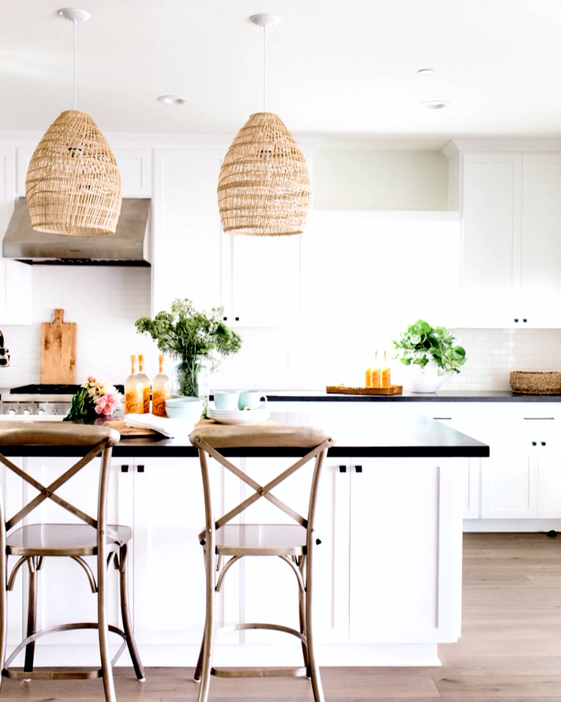 California cool kitchen with white cabinets and rattan pendant ...