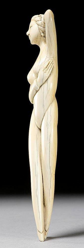 A CARVED IVORY DOKTOR'S LADY. China, 19th c. Length 15 cm.