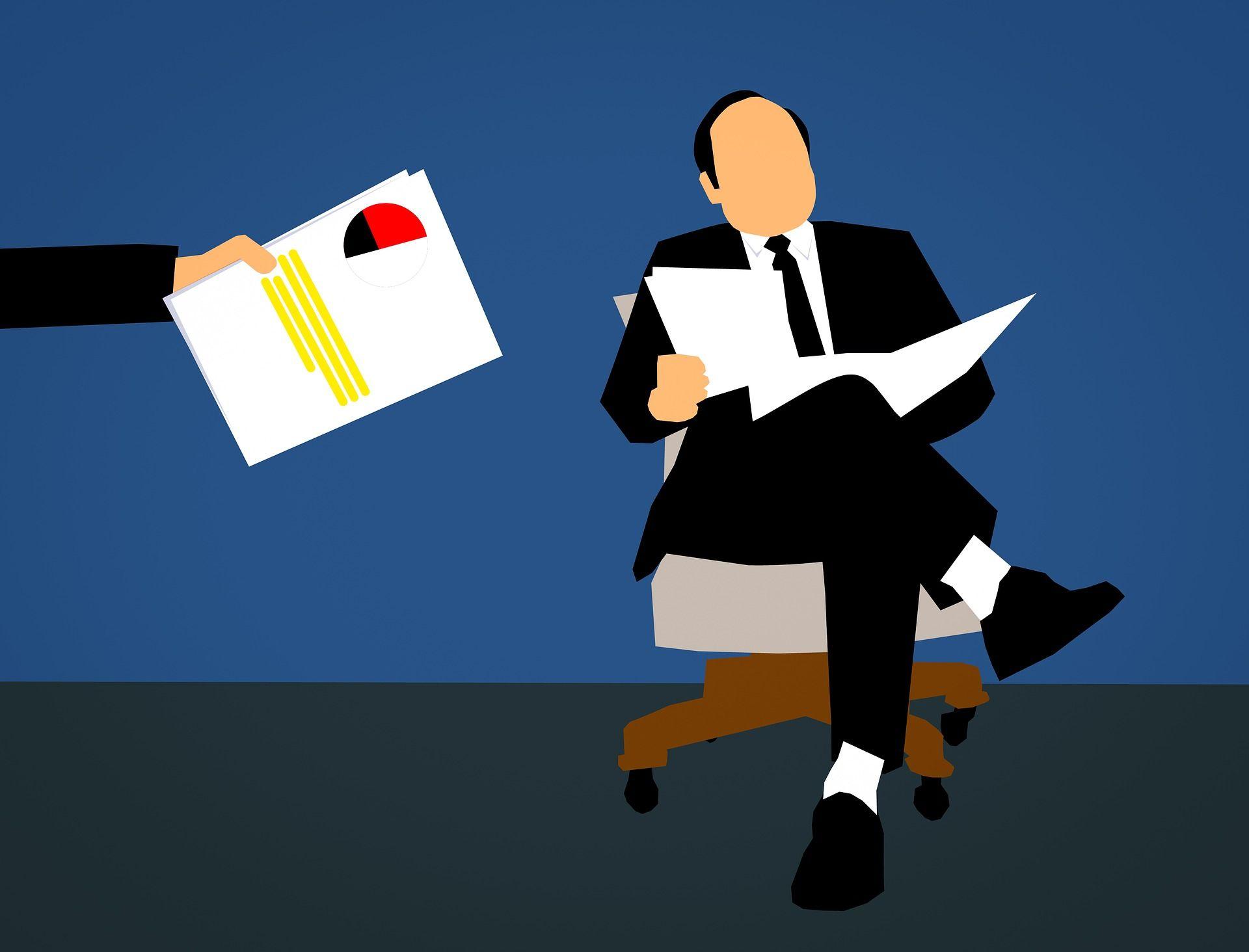 Man reading CV's