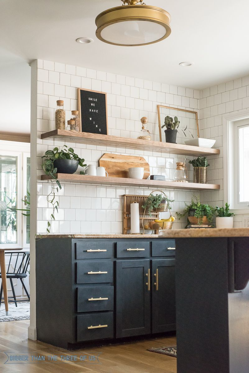 Open shelving in kitchen with dark white tile