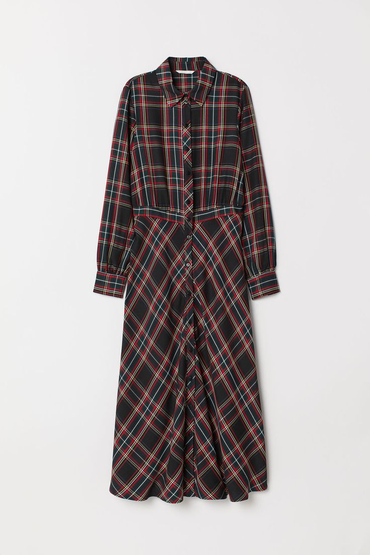 c589624a205c Wadenlanges Kleid aus einem Viskosestoff mit Jacquardmuster. Modell mit