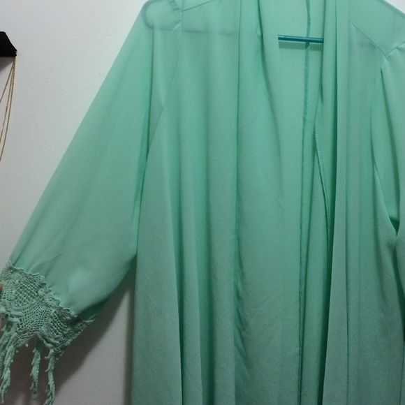 """Mint Kimono This is a mint, semi sheer, lace ended sleeves kimono. It doesn't look flattering on the hanger but it's super cute on (refer to pics). I'm 5'5"""", 115 pounds and it fit good (it's a quite flowy so could fit a lot of other sizes). Worn twice. Francesca's Collections Tops"""