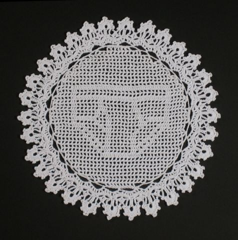 """Nathan Vincent.  My work...critiques stereotypical gender mediums by creating """"masculine objects"""" using """"feminine processes"""" such as crochet, sewing, and applique."""