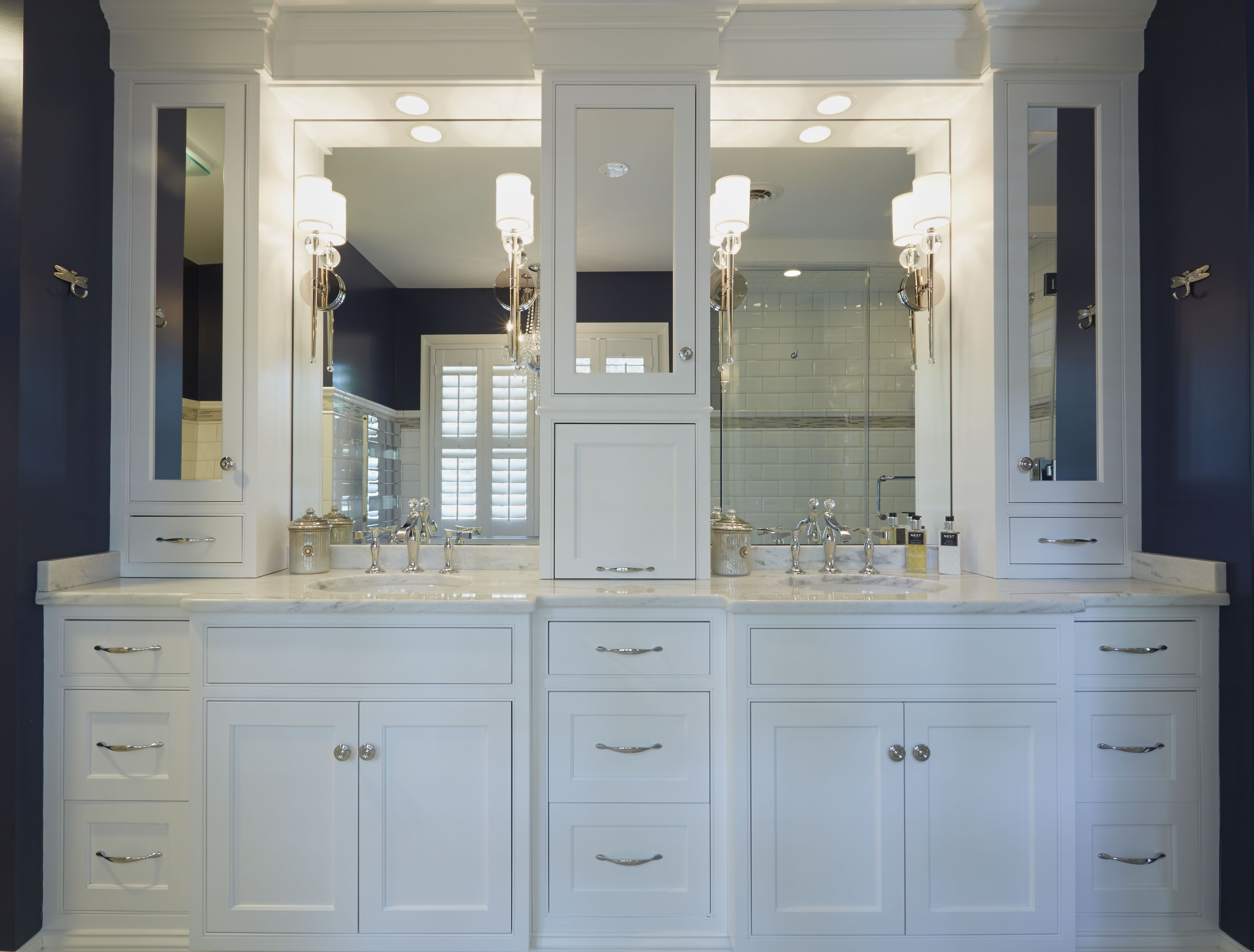 Double White Vanities With Mirrored Upper Cabinets And Lots Of Drawers For Storage