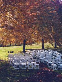 Simple outdoor ceremony underneath a canopy of autumn trees. ♥ So Perfect