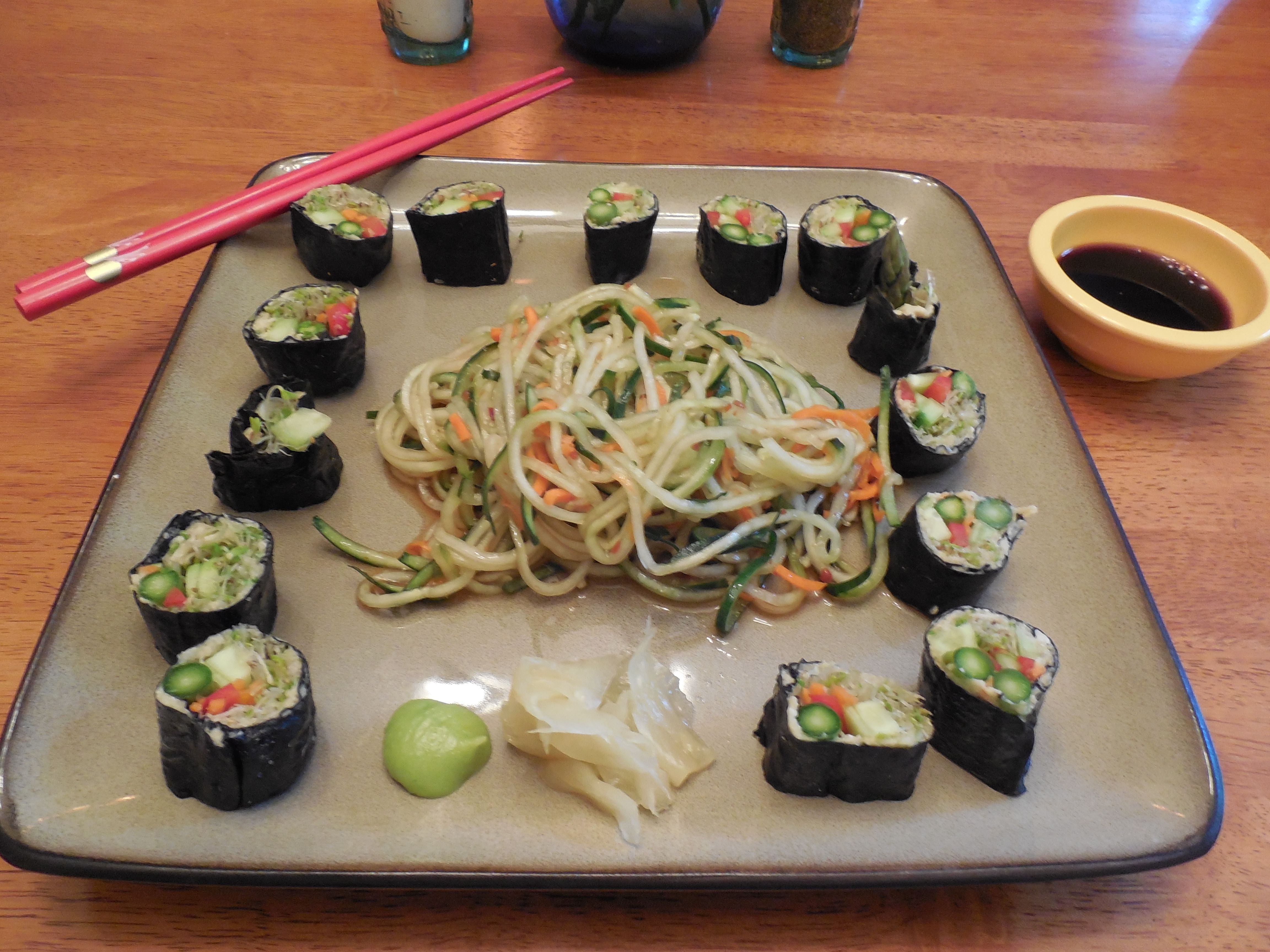 """I made this for dinner tonight (this is actually my picture!) Vegan sushi (hummus, sprouts, cuke, carrot, red bell pepper, and asparagus) and  cucumber/carrot """"noodles."""" This was DELICIOUS, and very filling!"""