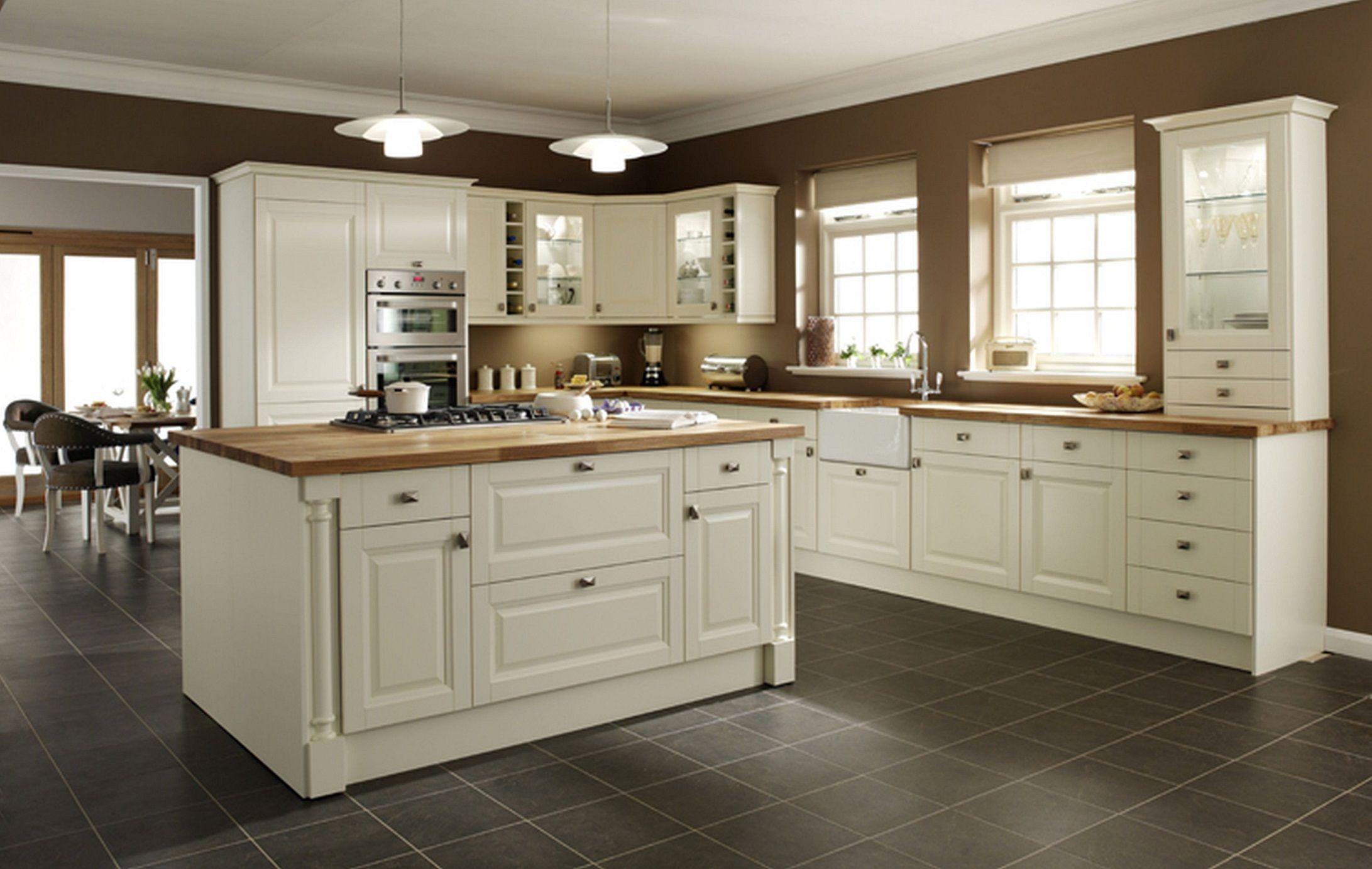 Dark Floors Cream Cabinets With Oak Wood Cream Kitchen Cabinets Kitchen Cabinet Design Best Kitchen Cabinets