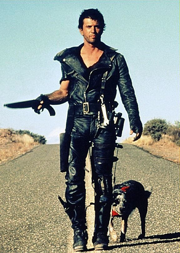 "Mel Gibson as MAX ROCKATANSKY & ""Dog"" The Road Warrior"