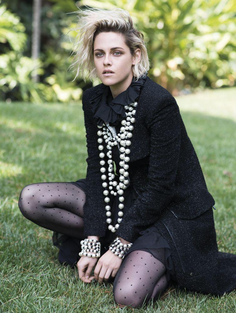 Kristen Stewart for Elle UK wearing statement layered pearls over a black ensemble.