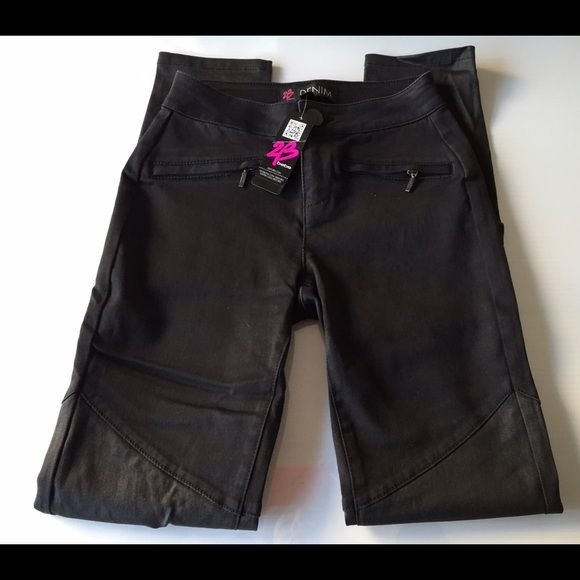 Bebe black skinny leggings size 24 new 2b Bebe black skinny legging jeans with a coated knee so cute ...please note these are tagged size 25 but run about a size small so these souls be perfect for a size 24 Xs xxs ...new with tags bebe Pants Skinny