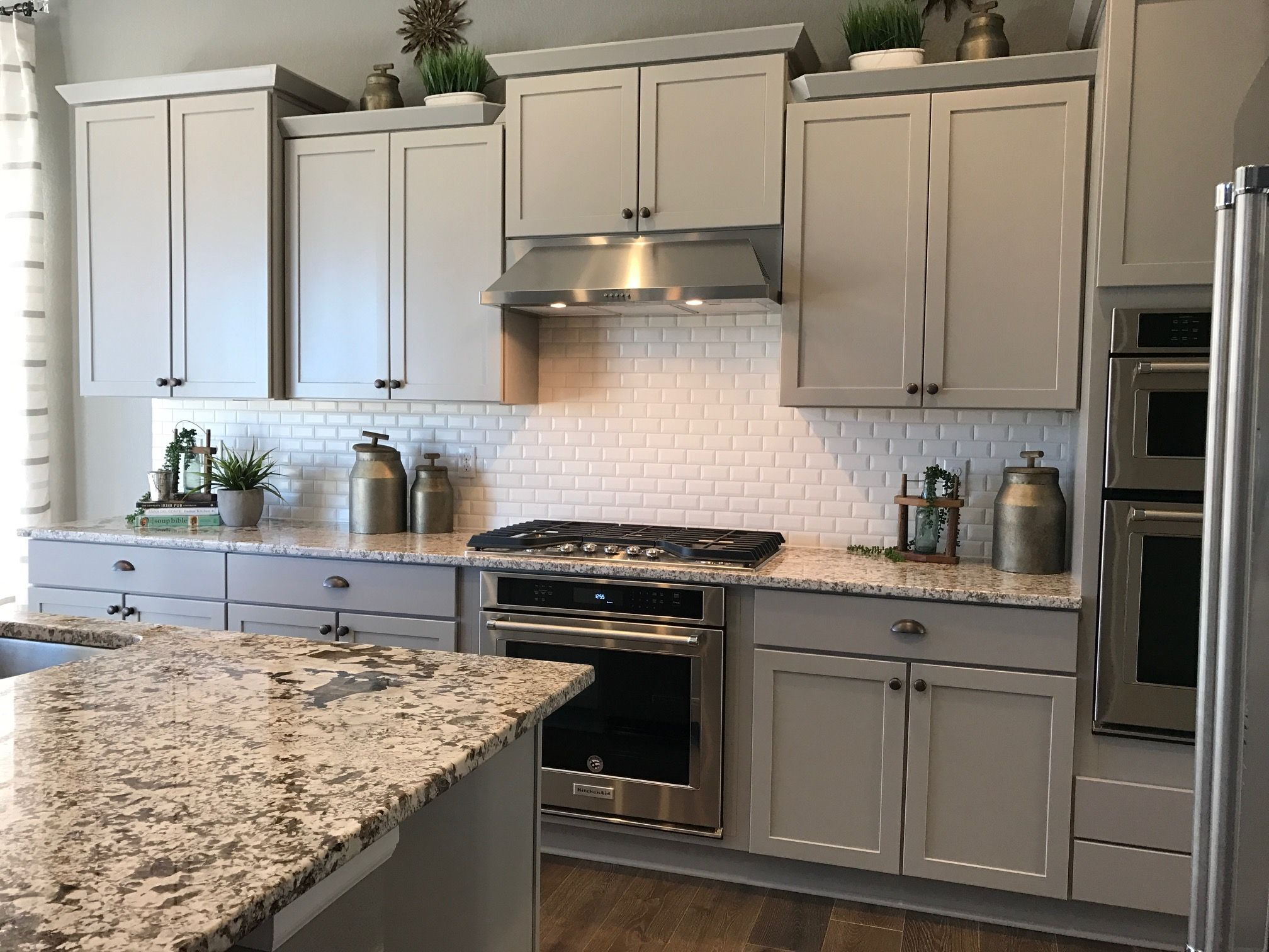 Merillat Portrait Style Shale Color Cabinets With Bianco Antico Granite And Vogue 2x4 White Matte Backsp Kitchen Cabinets Prices Rustic Kitchen Kitchen Design
