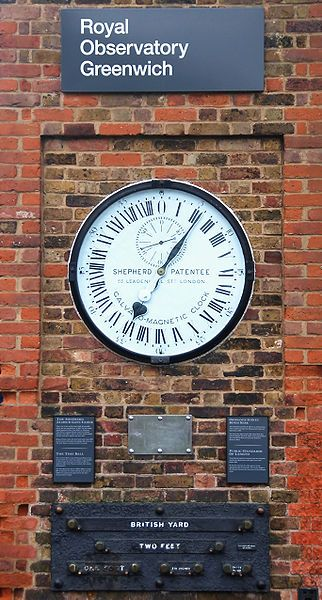 Greenwich clock, the world turns by it  (Or nearby London!)