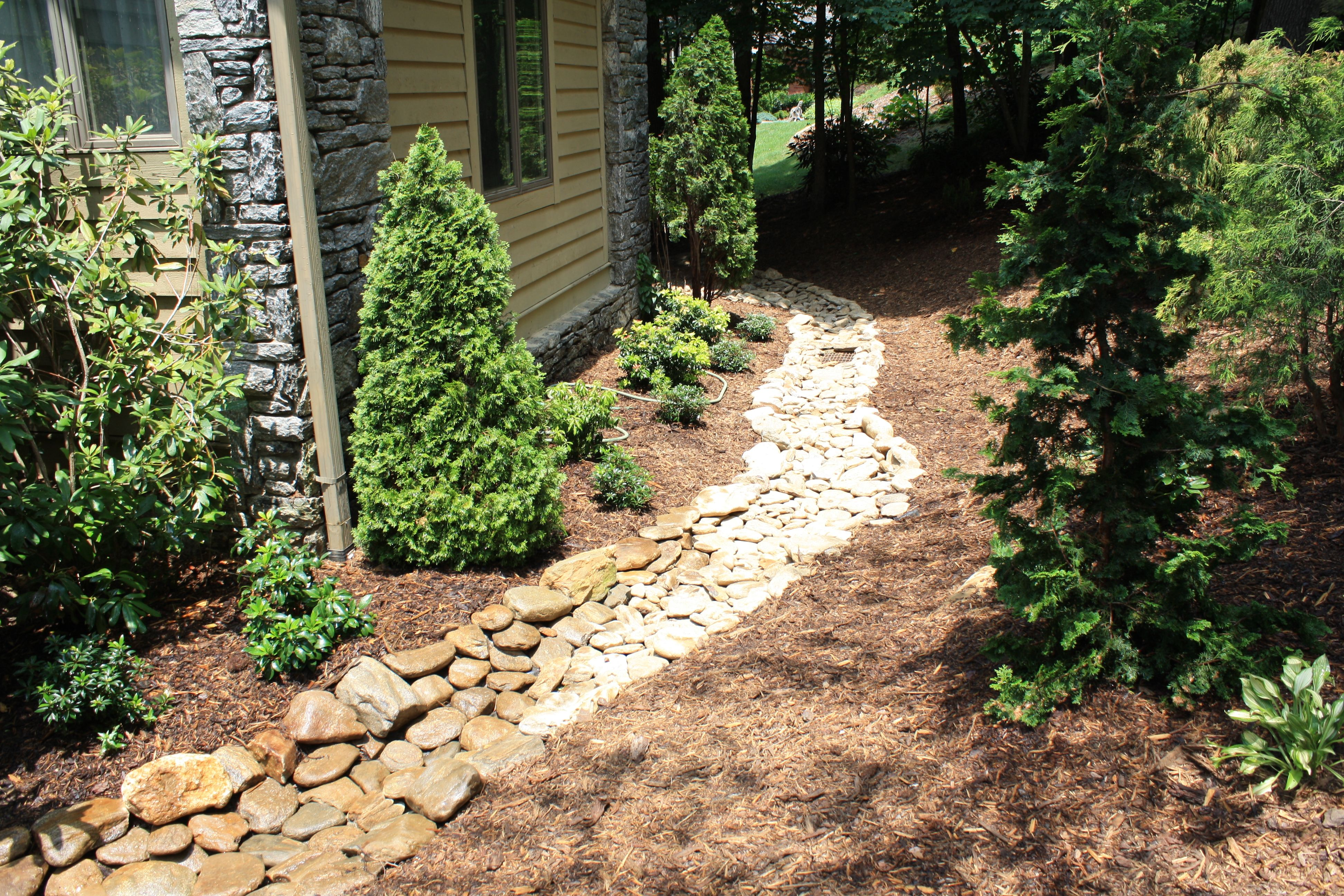 dry river rock bed Ideas for the new house Backyard