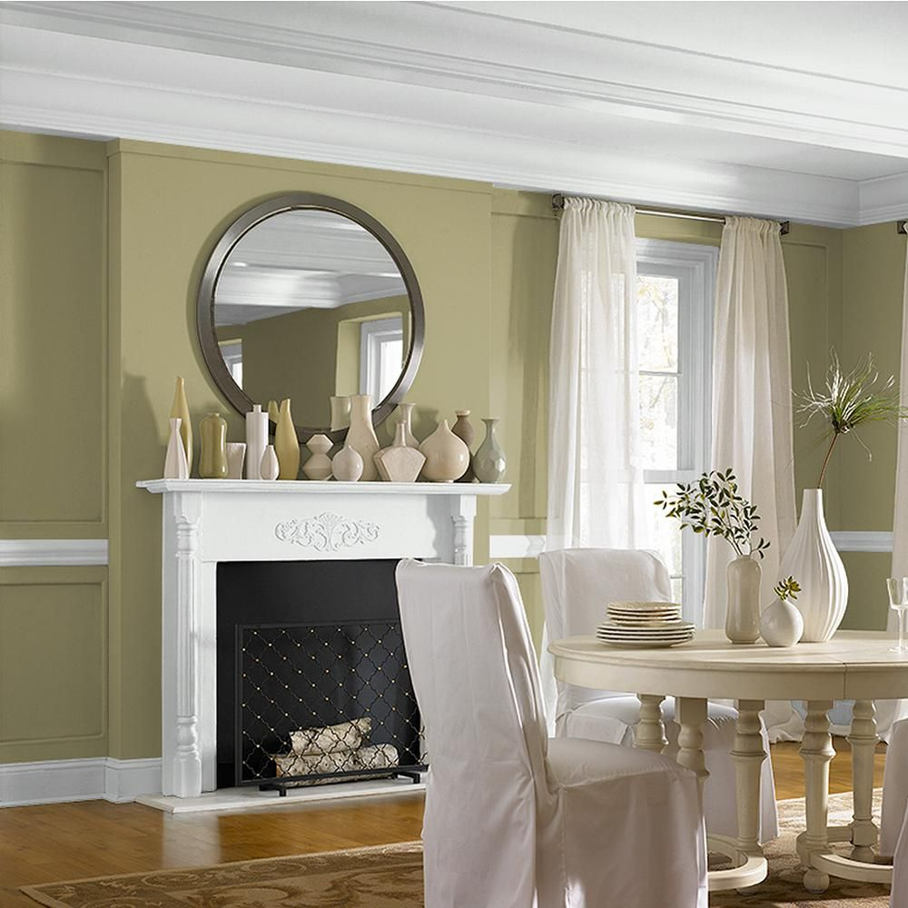 Lovely Green Tone In a Dining Room With White Trim Details