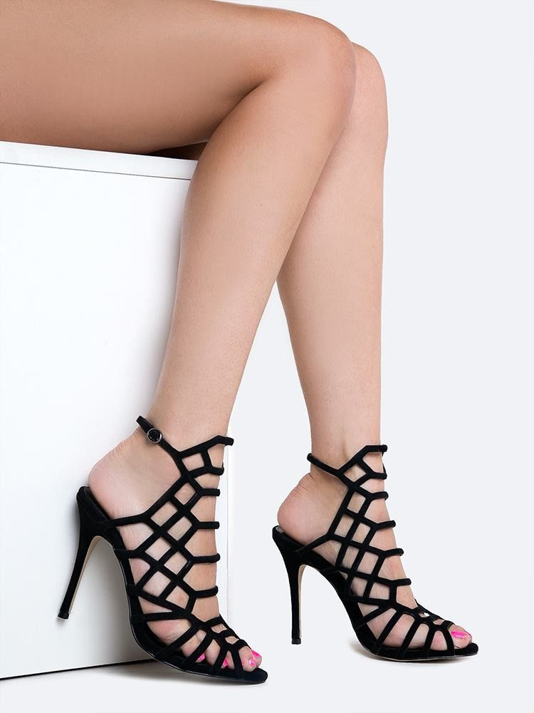 These strappy, cutout heels are a staple needed in every girl's closet! -