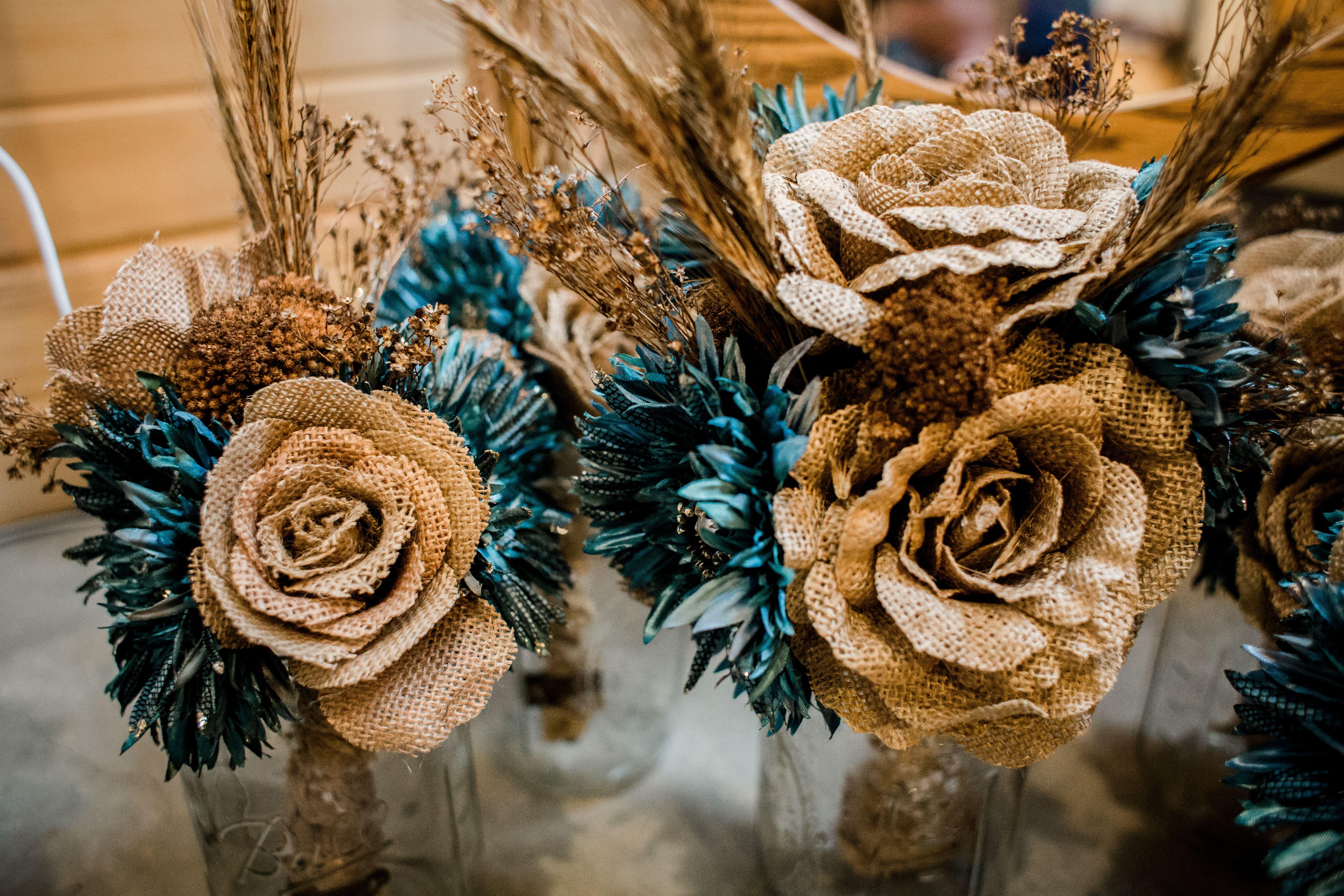 Diy brown and teal floral arrangements gettin hitched pinterest diy brown and teal floral arrangements izmirmasajfo