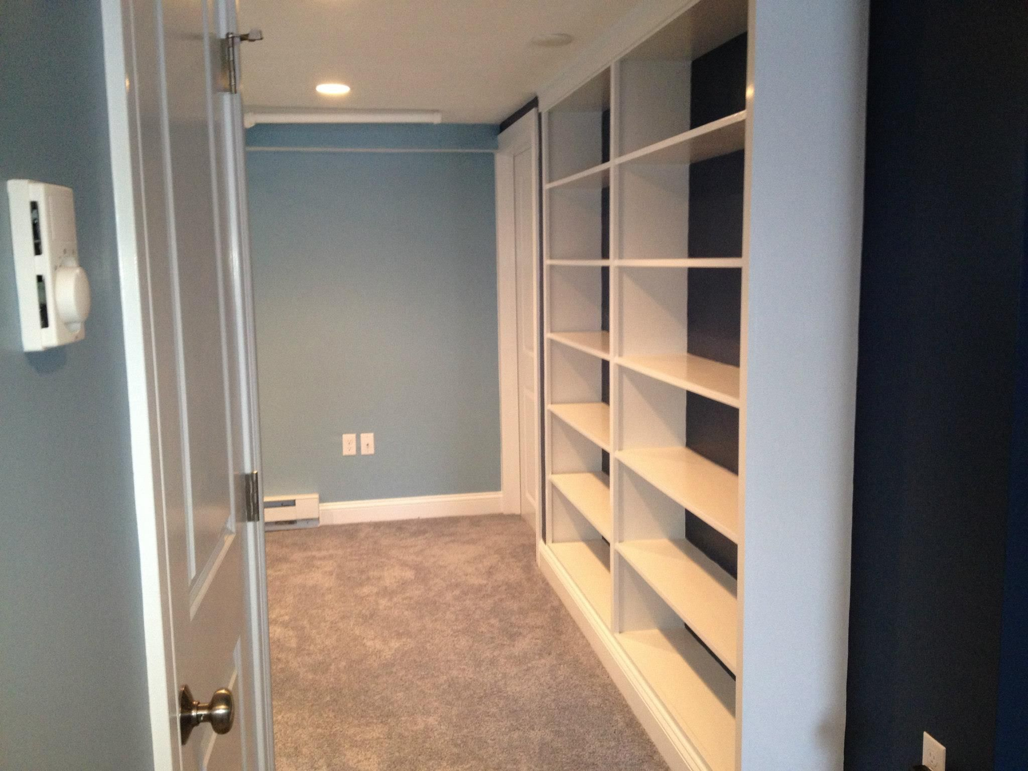 Shrewsbury, MA basement remodel with custom built-in shelving