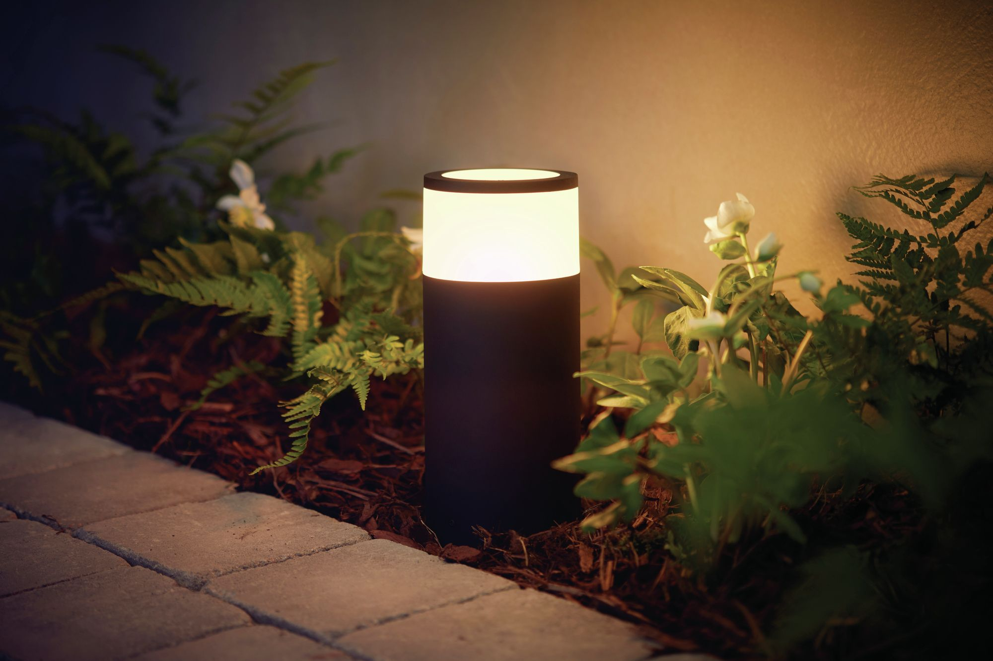 Philips Hue Takes Smart Light Bulbs Outdoors Set To Launch This July The Company S New Outdoor Lights Can B Outdoor Pathway Lighting Hue Philips Hue Lights