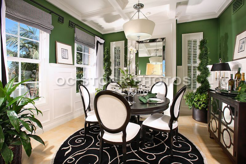 Interior decorated model home dining room with wainscoting panelling also rh pinterest