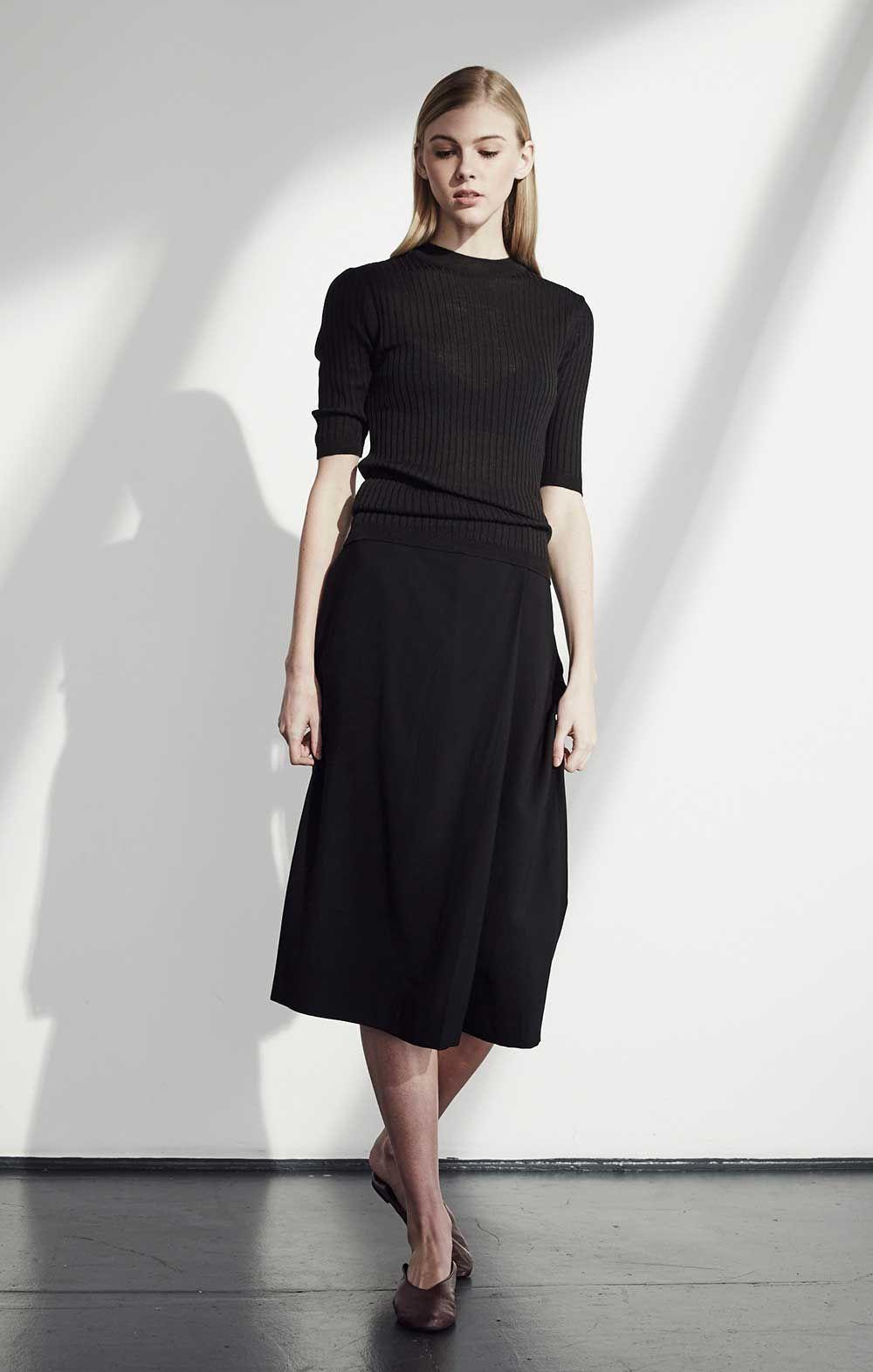 Black t shirt outfit - Black On Black Black Midi Skirt And Black T Shirt Minimalist Work Outfit