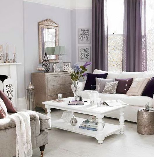 Decorating ideas for living spaces with white walls for Mauve living room decor