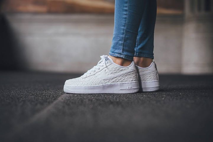 new arrivals b2563 aa94e ... On foot look at the Nike Air Force 1 07 LV8 White Croc.