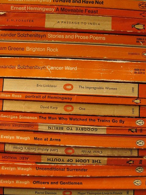 Colour coded books with orange spines. #inspiration #collection