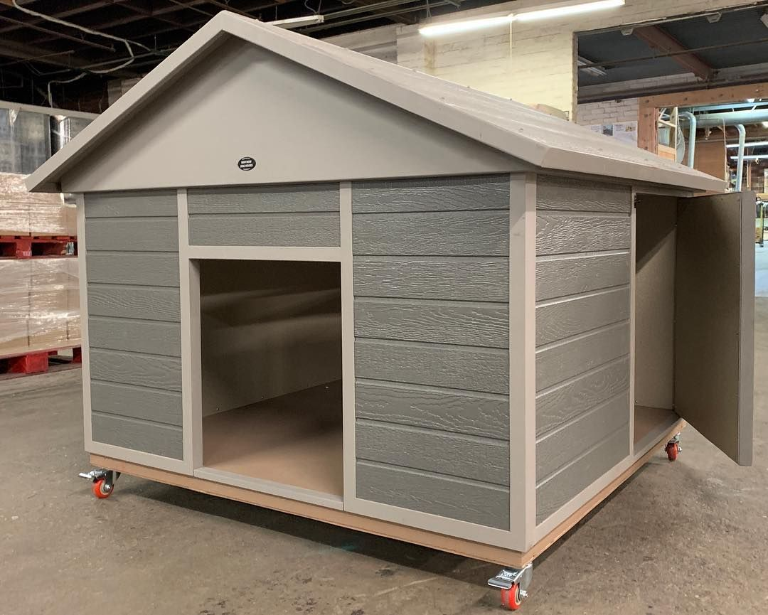 This Xxl Dog House With Side Swinging Door And Locking Wheels Is