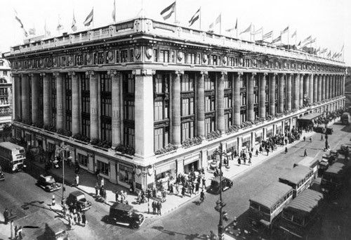Selfridges opened in 1909 and is the second largest store in London after Harrods. It was bombed 3 times during WWII causing extensive damage to the roof garden. The large display windows were bricked up as a safety precaution.