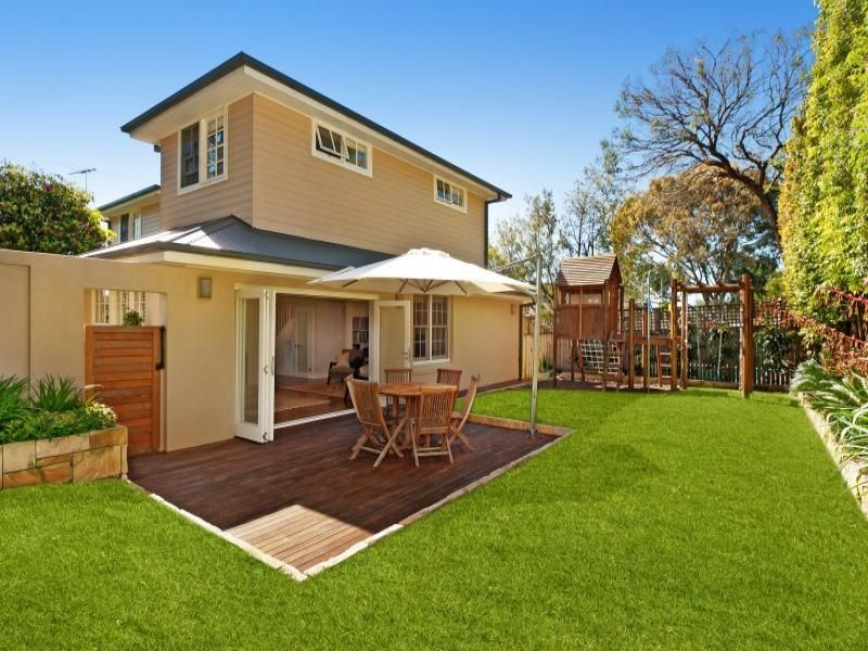 landscaped garden design using grass with deck hedging