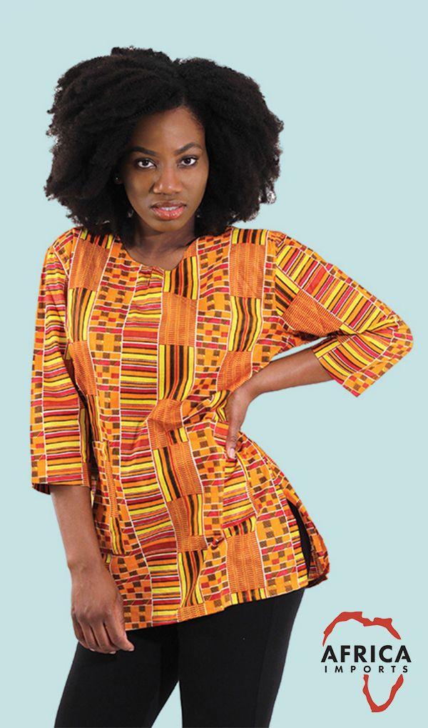 Womens African Kente Daishiki Shirt - Beautiful brightly colored African patterned shirt for women.  This African shirt celebrates African tradition with bright traditional Kente Cloth design.  Celebrate Black history with this beautiful African Daishiki shirt.  #african #africa #daishiki #fashion #style #blackhistorymonth #pattern #africanfashion #travelfashion #womensfashions