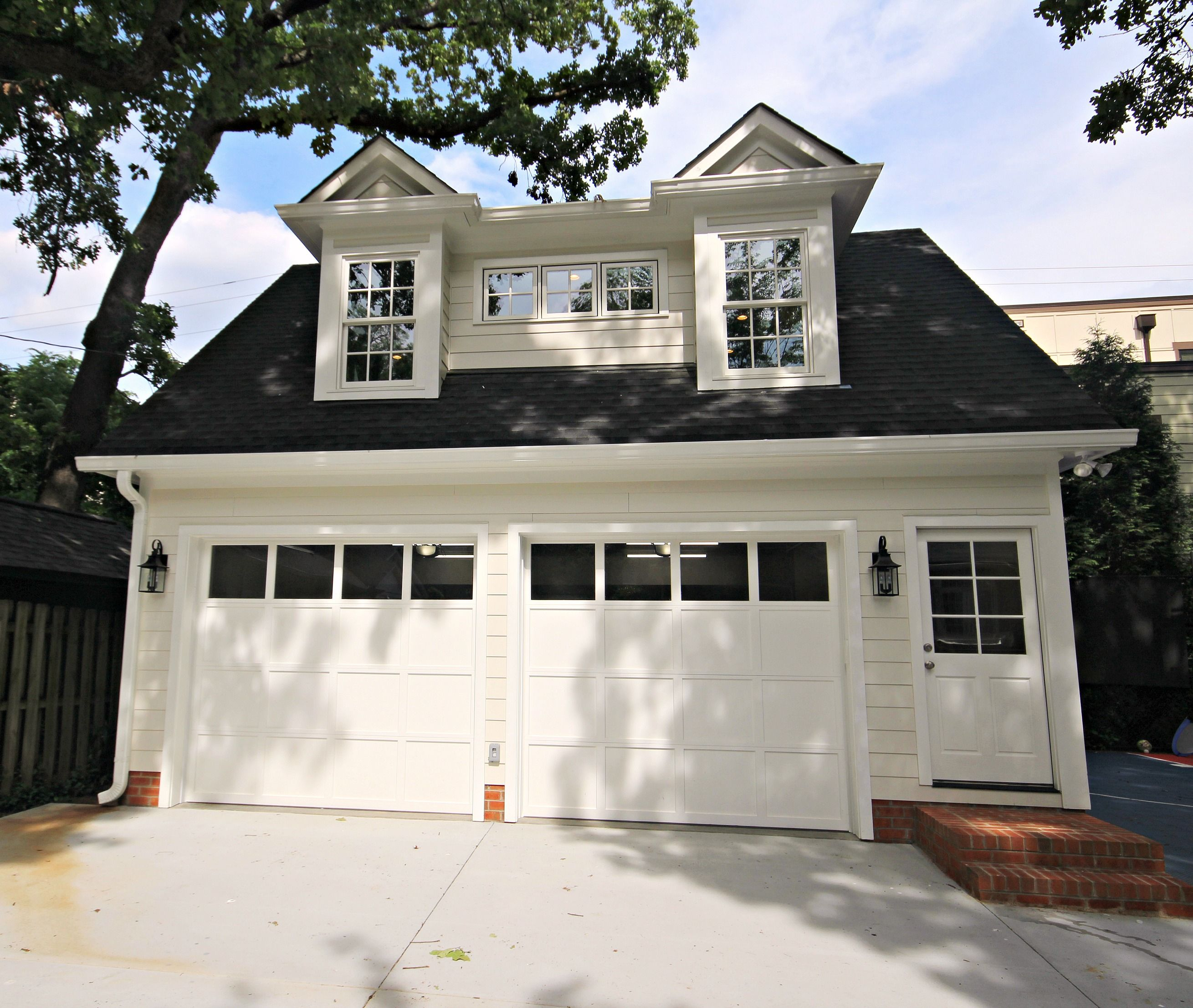 This Fantastic Garage Was Built In The Dilworth Historic District Our Homeowners Had A Dream To Turn T In 2020 Garage Door Styles Garage Guest House Garage Door Types