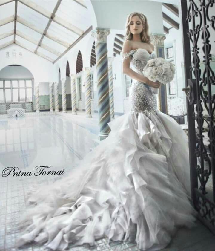 Our beautiful #PninaBride Elena. #ThatSkirt #ThatBeading #PninaTornai Photography by Brett Matthew VIA The Knot